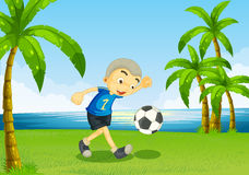 A young soccer player at the riverside with palm trees. Illustration of a young soccer player at the riverside with palm trees Royalty Free Stock Photos