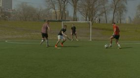Young soccer player scoring goal during match stock footage
