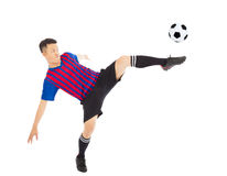 Young soccer player Steals the flying ball Royalty Free Stock Photography