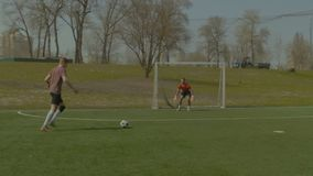 Young soccer player taking a shot on goal stock video footage