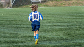 Young Soccer player. The young talented soccer player with the number 10 on the jersey. Heats up for the match. Friendly match between the teams Sumadija from Stock Photos
