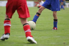 Young soccer players. Boys playing soccer. Detail of a soccer match Royalty Free Stock Photos