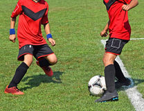 Young soccer players in action Stock Images