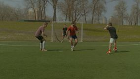 Young soccer players in action on sports field stock video