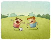 Young soccer players kicking ball Royalty Free Stock Photo