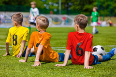 Young soccer players on the sport venue. Boys of sports team waiting for soccer game. Youth football team during school sport tournament Royalty Free Stock Photography