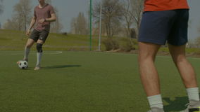 Young soccer players training football on the pitch stock footage