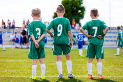 Young soccer team. Reserve players standing together and watchin. G football soccer tournament match for youth teams. Sports background Stock Photo