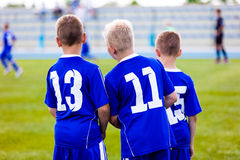 Young soccer team. Reserve players standing together and watchin Royalty Free Stock Photography