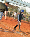 Young Softball Player Running to Base Royalty Free Stock Photography