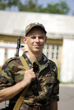 Young soldier. Poses with his rifle royalty free stock photo