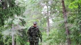 Young soldier with backpack in forest stock video footage