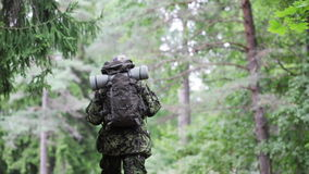 Young soldier with backpack in forest stock video