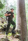 Young soldier with backpack in forest Royalty Free Stock Photography