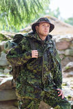 Young soldier with backpack in forest Royalty Free Stock Photo