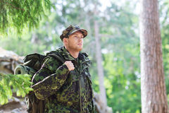 Young soldier with backpack in forest Royalty Free Stock Images