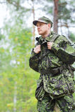 Young soldier with backpack in forest Stock Image