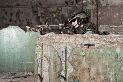 Young Soldier Behind Obstacle Royalty Free Stock Image