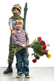 Young soldier and the boy Royalty Free Stock Image