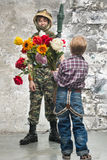 Young soldier and the boy Royalty Free Stock Photo