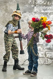 Young soldier and the boy Stock Images