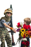 Young soldier and the boy Stock Photo