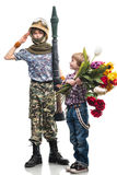 Young soldier and the boy Stock Photos