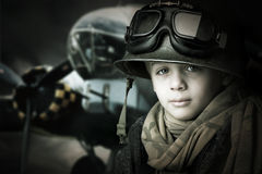 Young soldier. Young boy soldier in a dark background Royalty Free Stock Photo