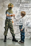 Young soldier and boy Stock Photo