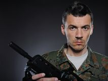 Young soldier in camouflage with a gun Stock Photography