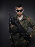 Young soldier in camouflage with a gun. Stock Image