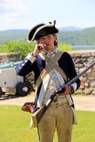 Young soldier demonstrating the loading of weapons,Fort Ticonderoga,New York 2014 Royalty Free Stock Photo