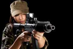 Young soldier with guns Royalty Free Stock Photography