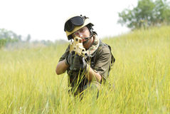 Young soldier in helmet targeting Royalty Free Stock Images