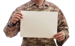 Young soldier holding a blank paper standing on white background royalty free stock image