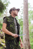 Young soldier or hunter with knife in forest Royalty Free Stock Photo