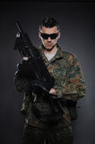 Young Soldier In Camouflage With A Gun. Stock Photo