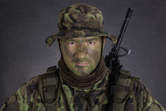Young soldier with jungle camouflage paint. Royalty Free Stock Photos