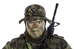 Young soldier with jungle camouflage paint. Isolated on white background royalty free stock image
