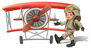 A young soldier near the plane Stock Photo