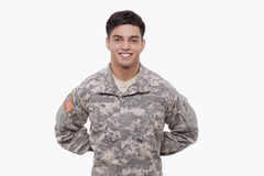 Young soldier at at parade rest. Smiling young soldier with hands behind back Stock Photos