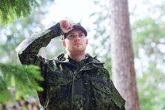Young soldier or ranger in forest Royalty Free Stock Image