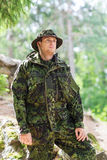 Young soldier or ranger in forest Royalty Free Stock Photos