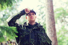 Young soldier or ranger in forest Royalty Free Stock Images