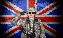 Young soldier salutes stock photo