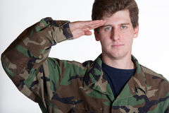 Young soldier saluting Stock Photos