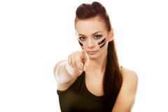 Young soldier woman pointing at camera Royalty Free Stock Image
