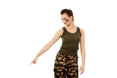 Young soldier woman pointing for something Royalty Free Stock Photography