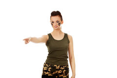 Young soldier woman pointing for something Stock Photo