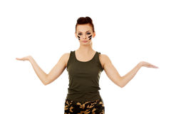 Young soldier woman presenting something on open palm Stock Photography